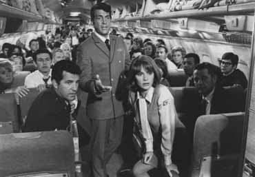 Airport (1970) directed by George Seaton, starring Burt Lancaster, Dean Martin, Jacqueline Bisset, Jean Seberg, Helen Hayes, George Kennedy, Van Heflin, Maureen Stapleton