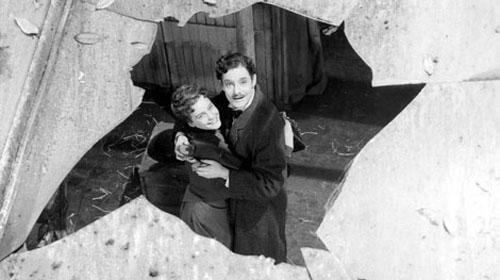 Maria Schell, Robert Donat in The Magic Box