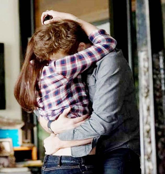 Robert Pattinson and Kristen Stewart embrace Breaking Dawn